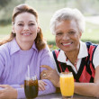 Two Female Friends Enjoying A Beverage By A Golf Course — Stock Photo