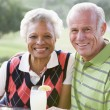 Couple Enjoying A Beverage By A Golf Course — Stock Photo