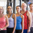 Stock Photo: Portrait Of Men And Women At The Gym