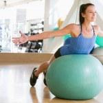 Woman Balancing On Swiss Ball — Stock Photo