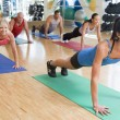 Instructor Taking Exercise Class At Gym — Foto Stock