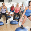 Stock Photo: Instructor Taking Exercise Class At Gym
