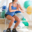 Woman Using On Balance Trainer At Gym — Stock Photo #4785377