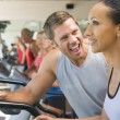 Personal Trainer Encouraging Woman Using Treadmill At Gym — Stock Photo #4785384