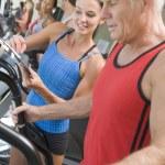 Personal Trainer Instructing Man On Treadmill — Stock Photo