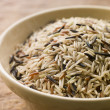 Bowl Of Uncooked Wild, Basmati And Red Carmague Rice — Stockfoto
