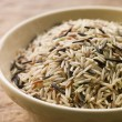 Bowl Of Uncooked Wild, Basmati And Red Carmague Rice — Stock Photo #4785544