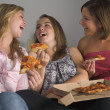 Stock Photo: Teenage Girls Eating Pizza