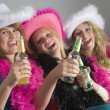 Foto Stock: Dressed Up Teenage Girls Enjoying Drinks