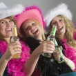 Stockfoto: Dressed Up Teenage Girls Enjoying Drinks