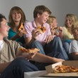 Foto Stock: Teenagers Having Fun And Eating Pizza