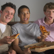 Foto Stock: Teenage Boys Enjoying Pizza