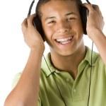 Teenage Boy Listening To Music On Headphones — Stock Photo #4785934