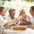 Friends Eating An Al Fresco Lunch, Holding Wineglasses — Stock Photo