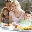 Stock Photo: Family Eating Al Fresco Meal