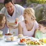 Family Eating An Al Fresco Meal — Stock Photo #4787086