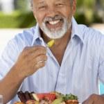 Middle Aged Man Dining Al Fresco — Stock Photo #4787122