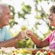 Stock Photo: Couple Eating Al Fresco Meal