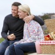 Couple Eating An Al Fresco Meal At The Beach — Stock Photo