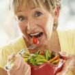 Senior Woman Eating Fresh Salad — Stock Photo
