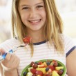 Young Girl Eating Fresh Fruit Salad — Foto de Stock