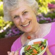 Senior Woman Eating Fresh Salad — Stock Photo #4787222