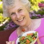 Senior Woman Eating Fresh Salad — Stock Photo