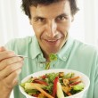 Mid Adult MEating Healthy Salad — Stock Photo #4787246