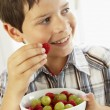 Stock Photo: Young Boy Eating Bowl Of Fresh Fruit