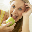 Mid Adult Woman Eating A Healthy Apple — Stock Photo