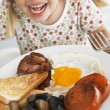 Foto de Stock  : Toddler Eating Unhealthy Breakfast
