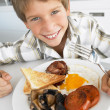 Young Boy Eating Unhealthy Fried Breakfast — Stock fotografie