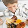 Young Boy Eating Unhealthy Fried Breakfast — Stockfoto