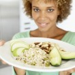 Mid Adult Woman Holding A Plate With Healthy Food - Stock Photo