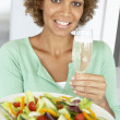 Mid Adult Woman Holding A Wine Glass And Fresh Salad — Stock Photo #4787326