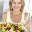 Mid Adult Woman Holding A Wine Glass And Fresh Salad — Stock Photo #4787327