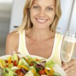 Mid Adult Woman Holding A Wine Glass And Fresh Salad — Stock Photo #4787328