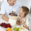 Stock Photo: Father And Son Making Fresh Vegetable Juice