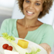 Mid Adult Woman Holding A Plate Of Healthy Food — Stock Photo #4787347