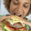 Mid Adult Woman Eating A Burger — Stock Photo #4787376