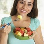 Teenage Girl Eating Fresh Fruit Salad — Stock Photo