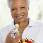 Senior Adult Eating A Fresh Fruit Salad — Stock Photo