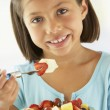Girl Eating A Bowl Of Fresh Fruit Salad — Stock Photo