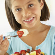 Stock Photo: Girl Eating A Bowl Of Fresh Fruit Salad