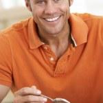 Middle Aged Man Eating Chocolate Cake — Stock Photo