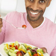 Middle Aged Man Eating A Salad — Stock Photo #4787629