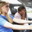 Stock Photo: Teenage Girl Taking A Driving Lesson