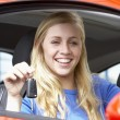 Teenage Girl Sitting In Car, Holding Car Keys And Smiling At The — Stock Photo