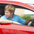 Teenage Boy Sitting In Car - Stock Photo
