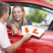Teenage Girl Receiving Her Learner Plates — Stockfoto